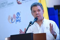 """Colombians, this award is yours!"" President Juan Manuel Santos celebrates winning Nobel Peace Prize."