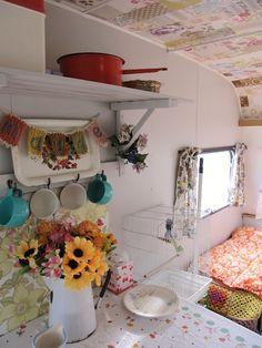 dottie angel: cute camper interior. looks like strips of wallpaper on the ceiling