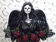 Dollar store angels turned Dia de los Muertos worthy skeletal angels of death. This is happening...