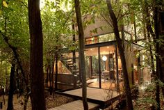 This small 2-story house sits in a deciduous forest on the outskirts of Santiago, Chile. It was designed by Parra + Edwards Arquitectos. The house is a simple rectangular box given architectural in...