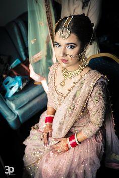 Sikh Wedding Brides - Pastel Pink Lehenga with Gold Mirror Work and Zari. Gold Maangtikka and Polki Jewelry | WedMeGood | #wedmegood #sikh #brides #pastel