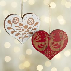 Rustic wood heart ornaments are screen printed with intricate, folk art-inspired designs that let the warm wood grain show through. Christmas Hearts, Christmas Card Crafts, Christmas Signs Wood, Handmade Christmas Decorations, Scandinavian Christmas Ornaments, Norwegian Christmas, Nordic Christmas, Painted Ornaments, Wooden Ornaments
