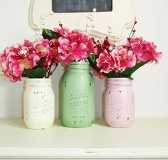 Painted mason jars with flowers | DIY Centrepieces That You Can Create With Almost No Effort | Weddingbells