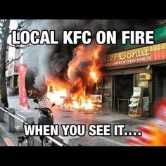 LOOK AT THE STORE NEXT TO THE BURNING ONE ...... IS IT A MONSTER DONUT?????!!!!!!