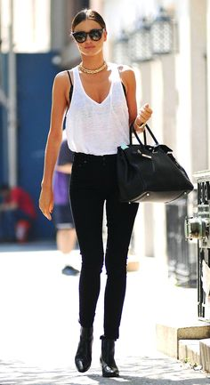 5 of Miranda Kerr's best summer looks // Celine sunglasses, chain necklace, white tank top, skinny black jeans & boots #style #fashion #celebrity #modelstyle