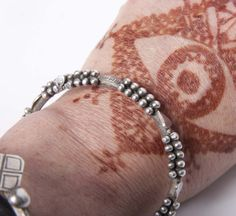 saharawi bracelet with henna tattoo by Sarah Corbett