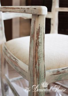 My chair went through this: Painted very blue, Provence chalk paint with Turquoise added. Painted dry brush to medium dry brush with ASCP Paris Grey mixed Provence. Rubbed with a damp cloth. Dry brushed with Old White chalk paint and some light waxing. Sanded to distress