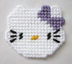 Hello Kitty magnet in plastic canvas purple bow by AuntCCcreations, $2.50