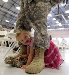 MacKenzie Avery, 2, crawls through the legs of her dad, Sgt. Kyle Avery of Preston, Tuesday during a homecoming for the Connecticut Army National Guard's 248th Engineer Company, at the ANG's Army Aviation Support Facility in Windsor Locks.