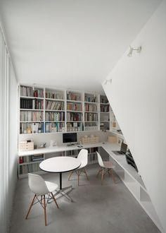Workspace - I approve of this small, intimate, yet bright studio/office/library. Modern and minimal but not too clinical.