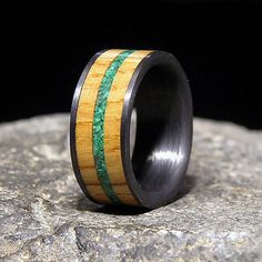 Ring pictured 10 mm wide band, with a 8 mm uncharred barrel wood inlay, and a 2 mm malachite inlay Inlaid with wood from whiskey barrels once used by the Jack Daniel Distillery Please zoom in on my pics to see the attention to detail, finish, and quality for comparison to others you may