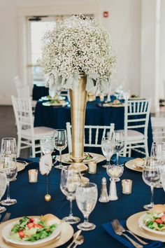 Gold vase with babys breath centerpiece