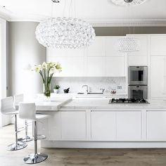 Glamorous white kitchen with crystal pendant light