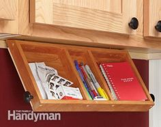 Organization Tips for Your Kitchen.  Drop down area for office supplies, possible instead of fold out desk