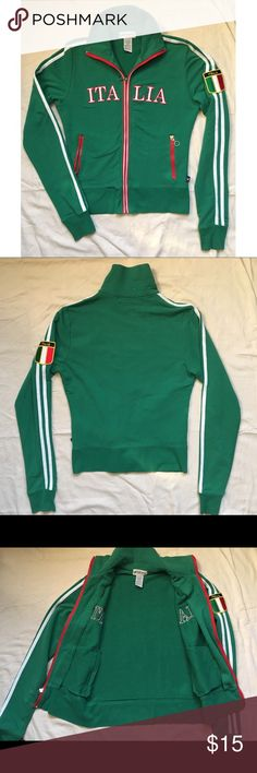 "Italia track jacket stripes 🇮🇹 Italy Small Great condition! And a great jacket! Medium weight. Zippered pockets. Stripes sleeves. Italy flag flag on sleeve. Has a couple really light spots on the back of the neck, I didn't notice until taking photos ( shown in photo ). Tag says Large so it may be a kids? Juniors? But I wear a small medium and it fits me comfortably snug. See measurements 👇🏾 60%Cotton/35%Polyester/5%Spandex 🇮🇹MEASUREMENTS🇮🇹 laying flat :: 22"" long • 18"" across bust •…"