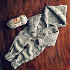 Baby Knitting Patterns Jumpsuit Ravelry: Baby Gray Jumpsuit pattern by Jenny Amshen Baby Hat Knitting Patterns Free, Baby Sweater Knitting Pattern, Knitting For Kids, Baby Overalls, Baby Jumpsuit, Ravelry, Jumpsuit Pattern, Jacket Pattern, Knitted Romper