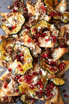 "autumn acorn squash pita ""nachos"" with pomegranates & blue cheese"