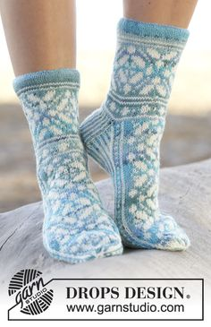 "Ice Magic - Knitted DROPS socks with Norwegian pattern in ""Fabel"". Size 35 - 43 - Free pattern by DROPS Design Lace Socks, Crochet Socks, Knitted Slippers, Wool Socks, Knit Crochet, Knit Lace, Fair Isle Knitting, Lace Knitting, Knitting Socks"