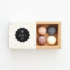 A sweet sampler box of 4 mini jewel soaps in 4 different scents