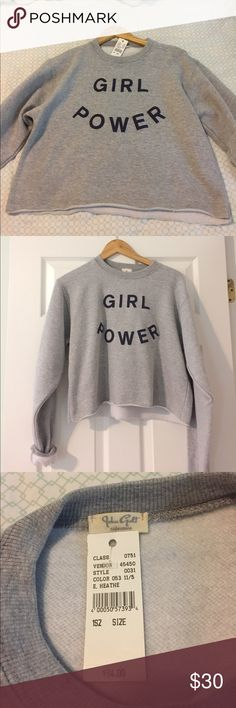 NWT Brandy Melville Girl Power Crop Pullover This pullover is soft and stylish! It says girl power and is new with tags. The sleeves are very long though so maybe roll them up. It's a little cropped. One size fits all but it's like a small/medium Brandy Melville Sweaters