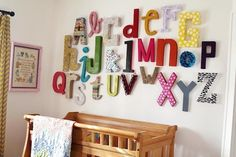 I have an inner craving to make an alphabet wall.  This would be so cute inside a school entrance, or even a living room.  Who wants one?  I'll help.