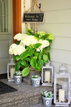 Front porch decor. snazz up the 1st place people see when they come over. How cool would this look with the PartyLite Weathered Zinc lanterns??? www.partylite.biz/scarvell