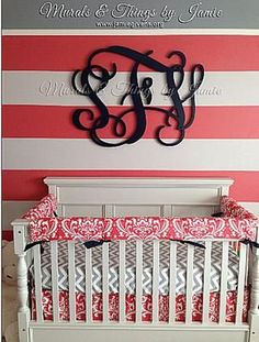 Lucious watermelon Pink, Gray and White Baby Girl Nursery a large wooden wall monogram. I love the elegant font used for the letters.