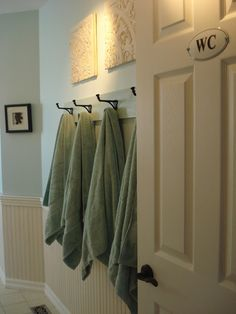 Coat hooks for towel rack in the bathroom. would be cute and helpful to have a name plate above each hook for each family member using that bathroom, or a letter for first name - painted wood letters, painted toy letter block, etc.