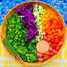FullyRaw   -    Somewhere over the FullyRaw rainbow! Tonight's salad is kale and romaine topped with rainbow bells, cucumber, purple cabbage, green onion, and cherry tomatoes with an orange tomato sesame dressing! Hakuna Matata!  Kristina Carrillo-Bucaram Rawfully Organic Co-op www.instagram.com/fullyrawkristina