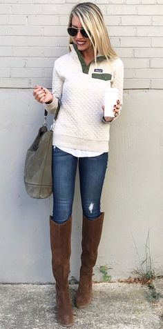 #winter #outfits women's quilted beige sweatshirt and distressed blue-washed jeans