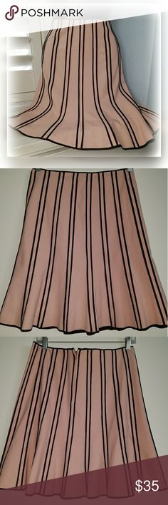 "I.N.C Pink Brown Pleated Pinup A-line Midi Skirt Simply gorgeous!   Excellent preloved condition  Perfect for that 50s kinda lover  Pale pink color  Stretchy  Light Pleats on bottom area  Soft semi -thick material  Size  2 (read measurements) Waist 30"" Hips 36"" Length 30""  Stop by my closet for more great spring fashion deals and bundle for less I.N.C Skirts A-Line or Full"