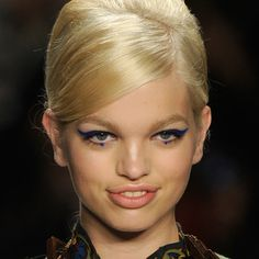 Graphic eyeliner ruled the Fall 2012 runways, including this bright azure color at Anna Sui.