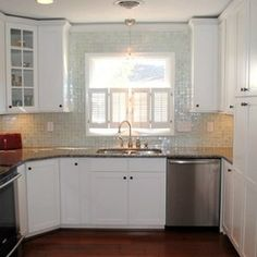 Kitchen Remodel with Maple Concord White Cabinets, Caledonia Granite