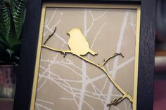 Laser cut bird on a branch with vintage wallpaper in a black frame on Etsy, $50.37 AUD