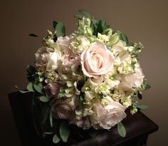 From the Wildrose Floral Design Wedding Gallery. White and Ivory Classic Wedding Bouquet- Roses, fragrant Stock, Alstroemeria and silver 'airy' foliage. Additional sizes and flower choices available. www.wildrosefloraldesign.net or check me out on Facebook