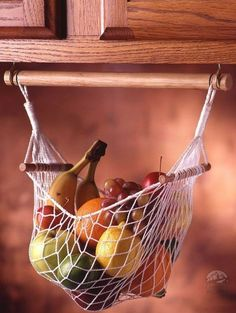 Hang a fruit and veggie hammock - this could be done on the cheap with a string bag! And there are lots of good ideas here! (44 Cheap And Easy Ways To Organize Your RV/Camper)