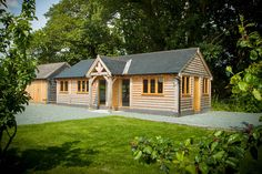 This granny annexe, located near Presteigne in Powys, provides ample living space for two people. Radnor Oak - Home Office - Oak Framed Office - Annex - Oak Garden Room - Oak Framed Building - Oak framed Summer House Oak Framed Buildings, Wooden Buildings, Garden Lodge, Oak Frame House, House Cladding, Bungalow House Plans, Bungalow Ideas, Small Space Interior Design, Garden Office