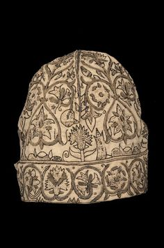 "1600-1620 English Nightcap at the Glasgow Museums, Glasgow - From the curators' comments: ""Traditionally plain linen nightcaps were worn in bed at night. However, at the end of the sixteenth and into the early seventeenth century embroidered nightcaps became popular. Their name of these embellished caps is a misnomer as these nightcaps were not worn in bed, but were a type of informal undress wear known as deshabille (undress), a relaxed dress style worn at home."""