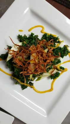 Our delicious Winter Salad of kale, pears & fried parsnips dressed in a roasted butternut vinaigrette. YUM! Available at Black Sheep in Rochester, NY. www.rocblacksheep.com