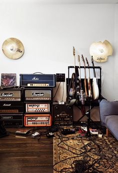 Beautiful music studio with some great guitars, amps, and pedals. Love the cymbals on the wall for decoration.