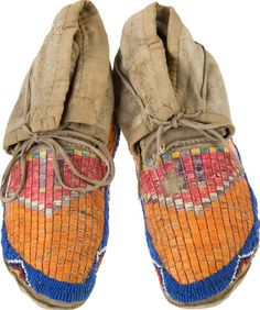 A PAIR OF HIDATSA QUILLED AND BEADED HIDE MOCCASINS. c. 1890