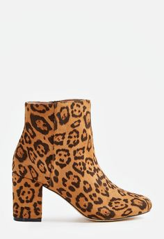 903caff71b4 A faux suede bootie featuring an inner zip closure and embroidered rose  design.