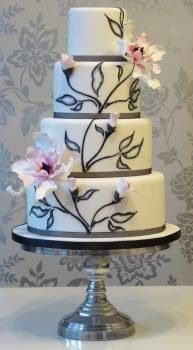 Beautiful and organic magnolia design.  Grey and pink wedding cake