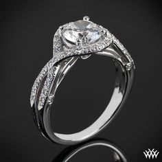 This Diamond Engagement Ring is from the Verragio Couture Collection. It features 0.35ctw of Round Brilliant Diamond Melee (F/G VS) that enhance a round diamond center of your choice. The width tapers from 3.0mm at the top down to 2.1mm at the bottom. Select your diamond from our extensive online diamond inventory. Please allow 4 weeks for completion. Platinum rings carry a 5 week turnaround time. If you have any questions regarding this item then please contact one of our friendly diamond an...