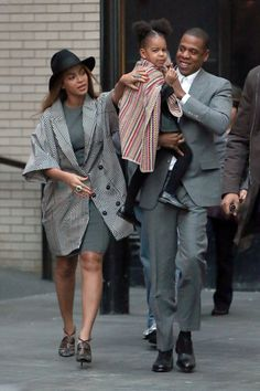 Beyoncé - #Flawlessly coordinated in shades of gray with daughter Blue Ivy adding a splash of color through a fashion-forward blanket coat.