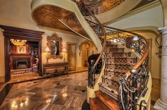 Traditional Staircase with High ceiling, Hardwood floors, Carpet
