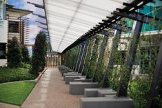Green Arbour at Lake Vista » Ronstan Tensile Architecture ... translucent overhang to filter light.