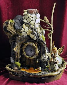 fairy house Love the use of the log and the fact that it is mobile