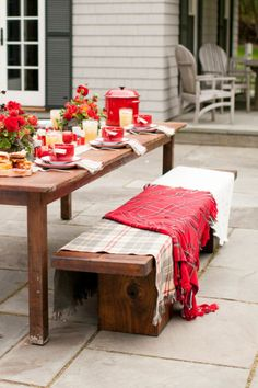 For an outdoor fall meal, take inspiration from Style Me Pretty Living founder and editor Abby Larson and cover seating with warm-hued blankets that keep the style (and your guests) cozy.