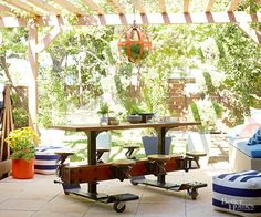 Flexible furniture choices maximize space in the backyard. Here, a vintage cafeteria table on wheels can serve as either a a dinner spot or a serving buffet depending on the occasion.